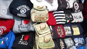 Souvenir Stand on the Streets of Venice. Venice, Italy - April 12, 2017: Souvenir Stand T-Shirts and Handbags on the Streets of Venice in San Marco Square, Italy stock video