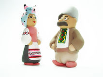 Souvenir. Ukrainian man and woman. Dolls in the ukrainian national clothes on a white background. Isolated Stock Photo