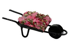 Souvenir - a wheelbarrow with ore. Pink quartz and metal it is isolated on a white background Stock Photos