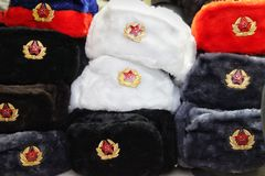 Souvenir winter hats with earflaps from Russia royalty free stock photos