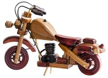 Souvenir Wooden motorcycle. On a white background side view Stock Image