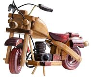 Souvenir Wooden motorcycle. On white background front view Stock Photo
