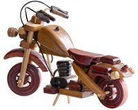 Souvenir Wooden motorcycle. On white background rear view side Royalty Free Stock Image