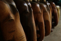 Souvenir wooden statues of elephants in the journey Stock Images