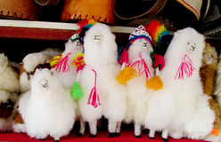 Souvenir wool llama figures. South America souvenirs sold on the street. Quechua Indian traditional carfts. Souvenir wool llama figures with colorful decoration Royalty Free Stock Image