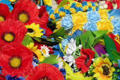 Souvenir yellow blue red artificial flowers Stock Photo