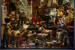 Souvenirs in Barcelona. Showcases colored Glass Souvenirs animals Stock Photos