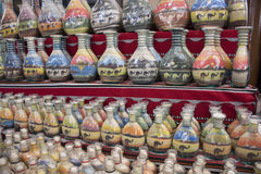 Souvenirs - bottles with sand and shapes of desert and camels, Jordan Stock Photos