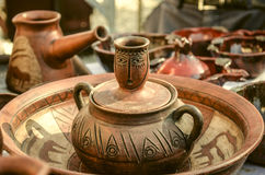 Souvenirs of clay pots for food with relief ornament. On Sunday clearance sale stock image