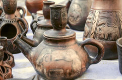 Souvenirs of clay teapots with relief ornament. On Sunday clearance sale stock photography