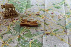 Souvenirs on the map of Rome. Coliseum. Royalty Free Stock Photography