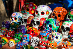 Souvenirs on the market at Chichen Itza. Maya Indians, skull, magnets, plates Royalty Free Stock Images