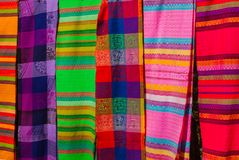Souvenirs on the market. Multi-colored clothes. National clothes of Mexico. Multicolored textiles being representative for the lat. In america culture. Shawl of Stock Images