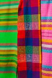 Souvenirs on the market. Multi-colored clothes. National clothes of Mexico. Multicolored textiles being representative for the lat. In america culture. Shawl of Royalty Free Stock Photography