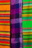 Souvenirs on the market. Multi-colored clothes. National clothes of Mexico. Multicolored textiles being representative for the lat. In america culture. Shawl of Royalty Free Stock Photos