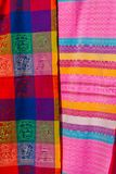 Souvenirs on the market. Multi-colored clothes. National clothes of Mexico. Multicolored textiles being representative for the lat. In america culture. Shawl of Royalty Free Stock Photo
