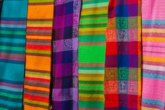 Souvenirs on the market. Multi-colored clothes. National clothes of Mexico. Multicolored textiles being representative for the lat. In america culture. Shawl of Royalty Free Stock Image