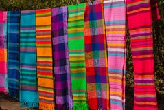 Souvenirs on the market. Multi-colored clothes. National clothes of Mexico. Multicolored textiles being representative for the lat. In america culture. Shawl of Stock Photos