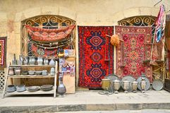 Souvenirs and old things on the shelves of Baku royalty free stock photo