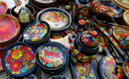 Souvenirs paintinted with flowers. Souvenirs wooden board painted with colorful flowers and birds sold on the street in Andreevsky spusk in Kiev, Ukraine stock illustration