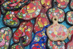 Souvenirs paintinted with flowers. Souvenirs wooden board painted with colorful flowers and birds sold on the street in Andreevsky spusk in Kiev, Ukraine Stock Photo