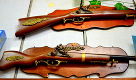 Souvenirs riffles at gift shop. Decorative rifles  at souvenir shop Royalty Free Stock Photography