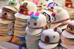 Souvenirs for sale in a night market in Vietnam. Nha Trang, Vietnam - February 6, 2016: Pretty hats are for sale in a local night market in Vietnam Royalty Free Stock Photo