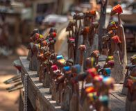 Souvenirs for sale, Swaziland craft market. Carved figures of colorfully dressed women on sale in a craft market in Southern Africa. Short depth-of-field is used stock photo