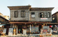 Souvenirs seller sits in his shop in the old part of Nessebar. The ramshackle building for sale in Old Town. Stock Photography