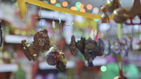 Souvenirs for Tourists. Hanging souvenirs for tourists. Many small traditional wooden toys hanging on a rope outdoors stock video footage