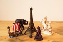 Souvenirs from travelling around the world. Bunch of souvenirs on wooden desk as metaphor of memory on realized trips, adventures, travellings and holidays royalty free stock images