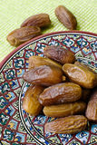 Souvenirs from Tunisia: dates and saucer Royalty Free Stock Photography