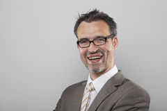 Souvereign smile. Souvereign winner type business man with designer glasses and stubbly beard laughing smile Royalty Free Stock Photography