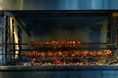 Souvlaki on charcoal. Souvlaki roasting on charcoal, a traditional Greek dish Stock Images