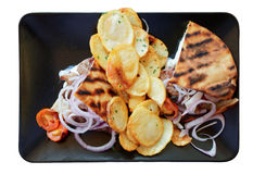 Souvlaki dish in black plate, isolated on white Stock Photos