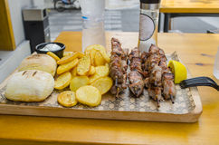 Souvlaki. Greek food wiht French fries and bread Stock Images