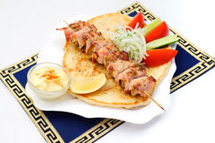 Souvlaki, kebab, grilled meat on pita bread with Royalty Free Stock Photos