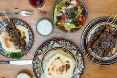 Souvlaki or kebab, meat skewer with pita bread and greek salad Royalty Free Stock Photography