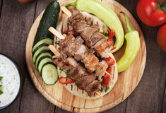 Souvlaki or kebab, meat skewer with pita bread. Souvlaki or kebab, grilled meat skewer with pita bread Stock Images