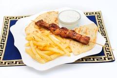 Souvlaki oder Kebab, gegrilltes Fleisch auf Pittabrot mit Stockbilder
