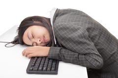 sova arbetare för skrivbordkontor Arkivfoto
