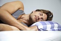 Sova för ung man Arkivfoto
