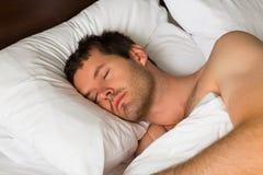 sova för man Fotografering för Bildbyråer