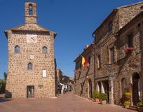 SOVANA, TUSCANY, ITALY JUNE 16, 2019: Ancient square in the old town founded in Etruscan times. Here is the Palazzetto. Dell` archivio ie the Town Hall. Maremma stock images