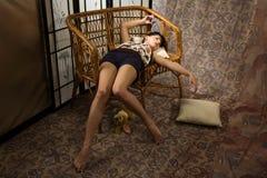 sovande boudoirbrunettlyx royaltyfria foton