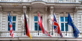 Sovereign flags on old building Royalty Free Stock Photo
