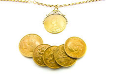 Sovereigns. Five gold sovereigns with a sovereign on a chain with a white background Stock Images