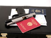 Soviet agent 0077. Soviet passport and Usa passport with handgun and map and case Royalty Free Stock Photography