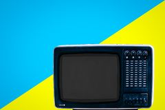 The Soviet analog retro TV on blue ad yellow background stock photography