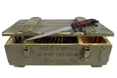 Soviet army ammunition box with bayonet. Text in russian - type of ammunition (RGD 5 UZRGM - hand grenade), lot number and. Soviet army ammunition box with royalty free stock photo